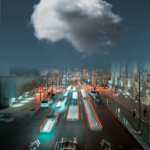 """A picture of a road at night, cars are driving towards an empty sky with a giant cloud in the middle - symbolizing """"the cloud"""" as used to describe internet services"""